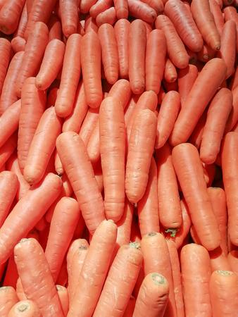 Fresh carrots as background color Orange