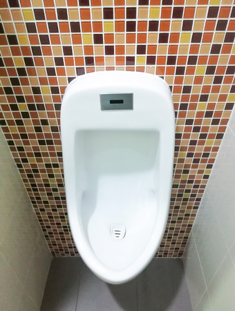 Mens urinal in the bathroom Stock Photo