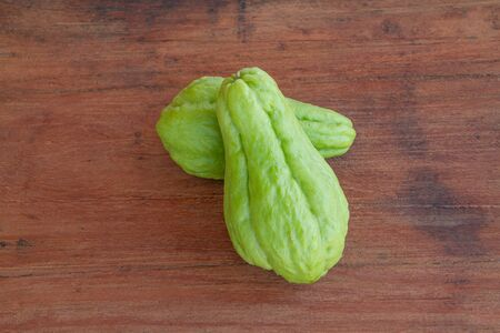 chayote on a wood background