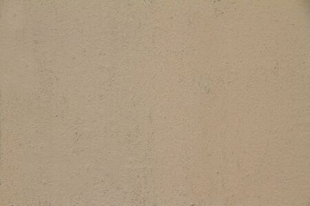 Cream colored cement background and texture