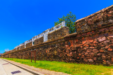The ancient Songkhla city wall and blue sky.