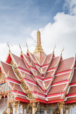 Beautiful temple is being renovated. In the sky with the clouds in the rainy season.