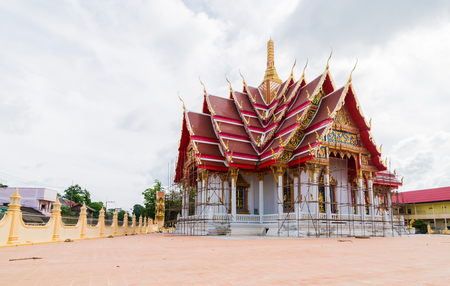 renovated: Beautiful temple is being renovated. In the sky with the clouds in the rainy season.