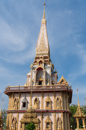 The ancient gold and white pagodas are dominated by the blue sky.