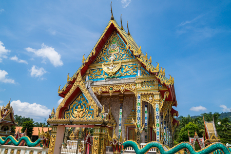 The beautiful temple of Thailand in the bright sky and clouds