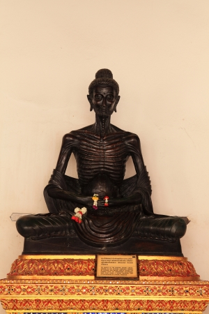 subduing: Buddha seated cross-legged in the attitude subduing himself by fasting  Stock Photo