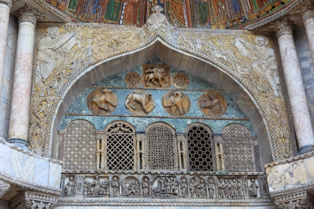 doge's palace: Fresco on the exterior main entrance to the Basilica de San Marco in Venice Italy