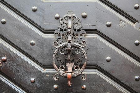 doorknocker: Doorknocker on allwood door  Stock Photo