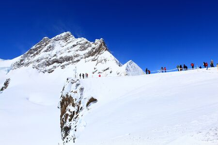Alpine Alps mountain landscape at Jungfraujoch, Top of Europe Switzerland photo
