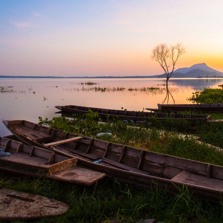 A colorful sunset sky on the waters of Bangpra Lake reservoir  photo