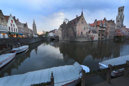 belfort: Bruges, Belgium. Image with Rozenhoedkaai in Brugge, Dijver river canal twilight and Belfort (Belfry) tower.