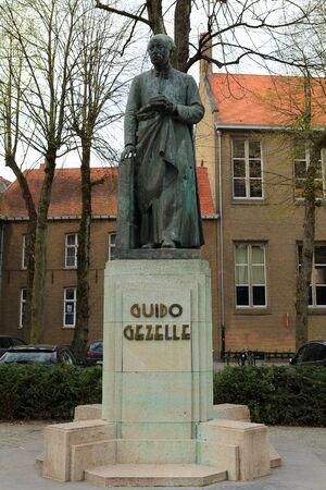 Bronze statue of the Flemish poet en priest Guido Gezelle Bruges, Belgium, Europe Stock Photo