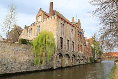 belfort: Bruges, Belgium. Image with Rozenhoedkaai in Brugge, Dijver river canal with Belfort Belfry tower. Flanders landmark. Stock Photo