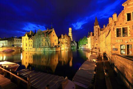 belfort: Bruges, Belgium. Image with Rozenhoedkaai in Brugge, Dijver river canal twilight and Belfort Belfry tower.