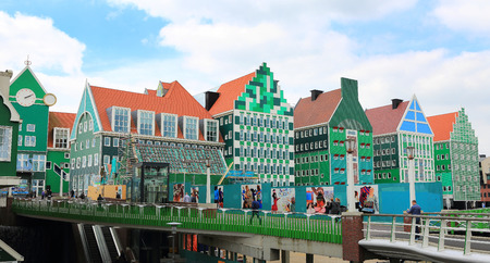 zaan: ZAANDAM, NETHERLANDS - APR 19: Inntel Hotel on 19 Apr 2015 in Zaandam, NL. Opened in 2009, the design attracts guests by incorporating the traditional architecture of the Zaan region.