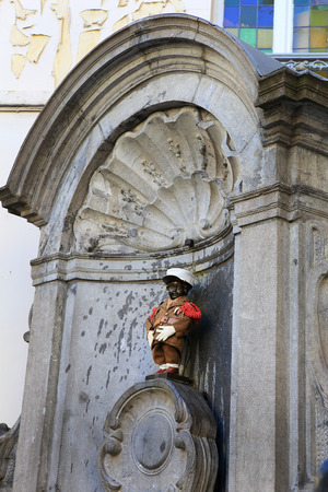 BRUSSELS, BELGIUM - April 18: Manneken Pis statue in Brussels. Statue of a pissing boy in a beautiful summer day in Brussels, Belgium on April 18 2015