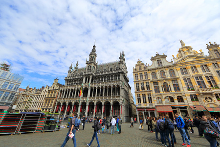 the place is important: BELGIUM, BRUSSELS - April 17, 2015: Grand Place in Brussels with unidentified people. The square is the most important tourist destination and memorable landmark in Brussels Editorial