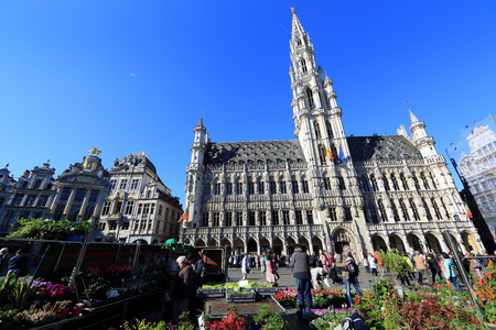 the place is important: BELGIUM, BRUSSELS - April 18, 2015: Grand Place in Brussels with unidentified people. The square is the most important tourist destination and memorable landmark in Brussels
