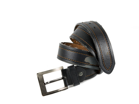 Old leather belt with buckle isolated on white background