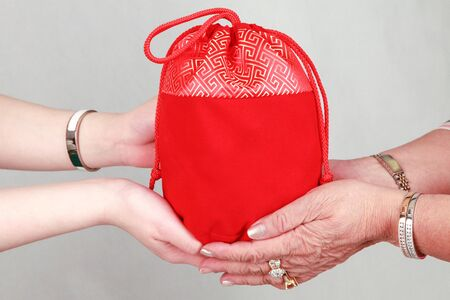 giving gift: Giving gift from hand to hand