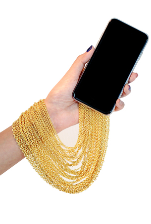 gold necklace: gold necklace on hand Stock Photo