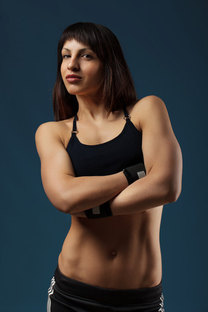Portrait of a beautiful athletic girl in the studio photo