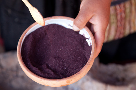 peruvian ethnicity: Ground dried cochineal in bowl Stock Photo