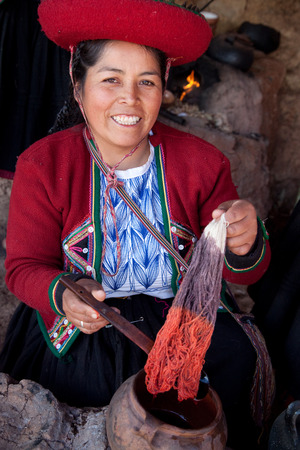peruvian ethnicity: Demonstration of alpaca wool color dyeing by Peruvian woman