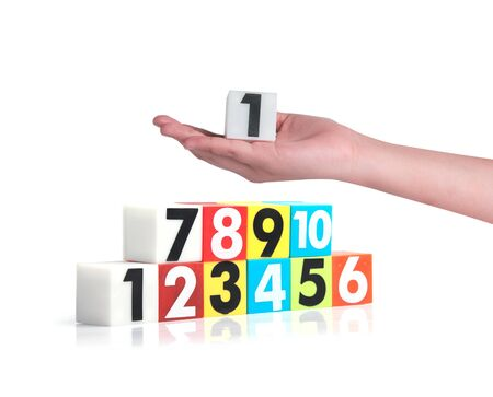 no1: Hand holding colorful plastic numbers on a white background ,No1