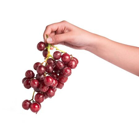 hand cut: Hand holding grapes isolated on white background Stock Photo