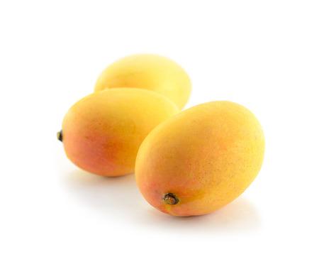 Ripe mangoes isolated on a white background.