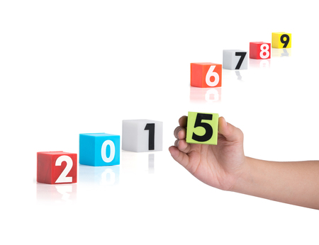 Colorful plastic of year numbers on a white background photo