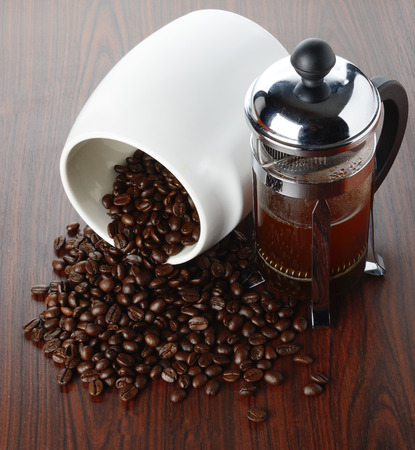 addictive drinking: Coffee beans on wood texture