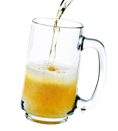 pouring beer: pouring beer into the glass isolated on a white background