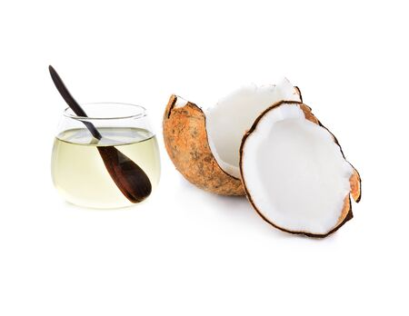 coconut oil with pieces of coconut isolated on white