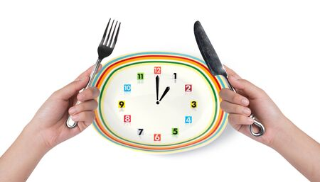 household objects equipment: plate with handing steak knife and fork on white background Stock Photo