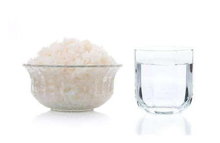 cooked rice and glass of water isolate one white background