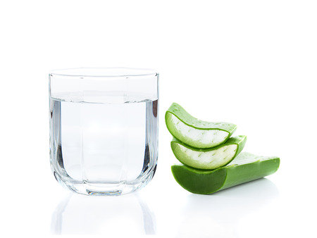 aloe vera fresh leaf and drinking water on white background