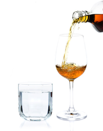 pour whisky into glass and drinking water Banque d'images