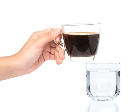 female hand holding cup of coffe with drinking water