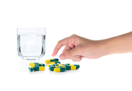 antidepressants: Drug capsules and drinking water on white background