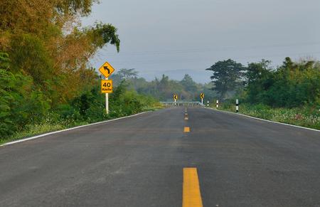 curve: curve sign road
