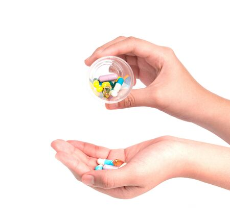 antidepressants: Druge capsules and pills in hand