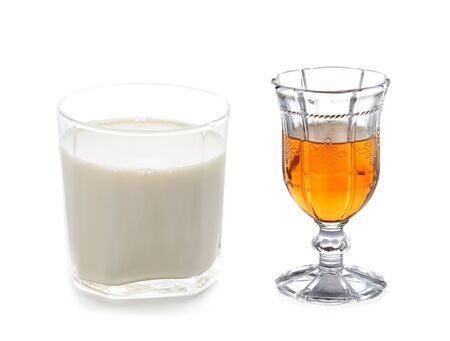 whiskey before meal and milk on white background