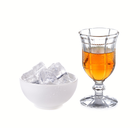 whiskey before meal and Ice cube in the cup on white background Banque d'images