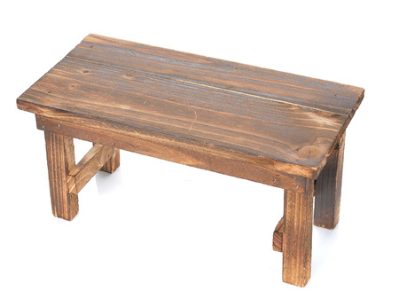 Wooden table isolated on white background Фото со стока