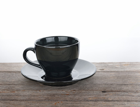cup of coffee on wood texture