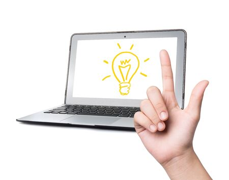 peripherals: hand and light bulb on laptop ,Idea concept