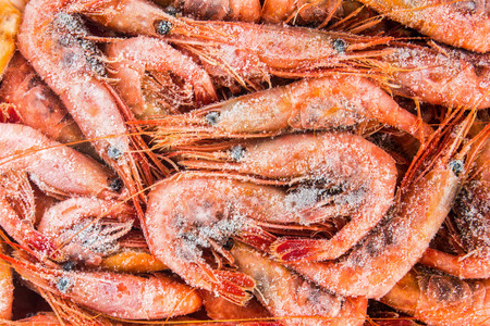 cold meal: frozen shrimp in a box for sale on the market Stock Photo