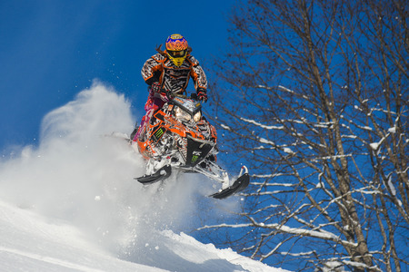 sakhalin: SAKHALIN RUSSIAN - JANUARY 23: Oleg Bibikov moving snowmobile in winter forest in the mountains of Sakhalin Island in Sakhalin sprint 2015 on January 23, 2015 in Sakhalin Russia